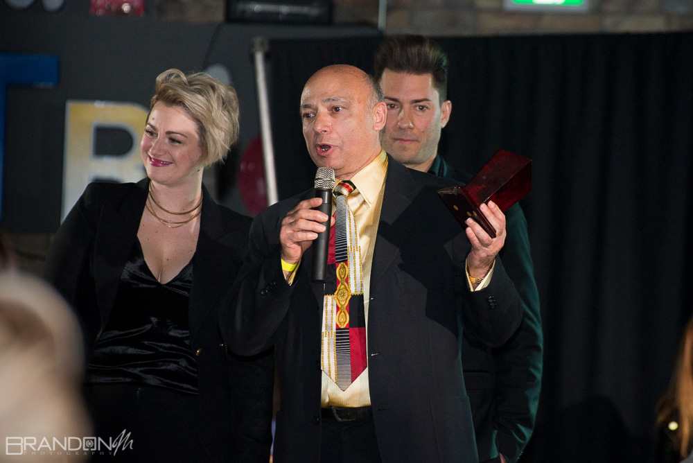 Raimondo Bianchi Owner of Bianchi's Hair Designs receiving award from Acqua Hair Salon at BLO 2.0 in Guelph By Brandon Marsh Photography