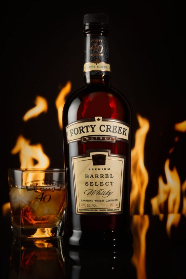 Forty Creek Whiskey Fire Product Photo in studio with black fire backdrop By Brandon Marsh Photography in Guelph, Ontario Canada