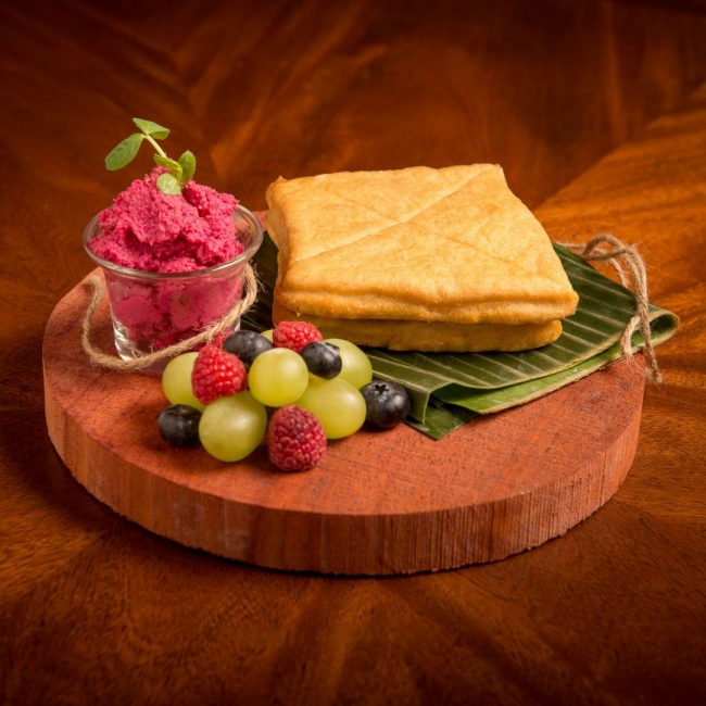 Food photography of Lamas bread with beet hummus and fruit By Brandon Marsh Photography for The Round Table Board Game Cafe Menu in Guelph, ON