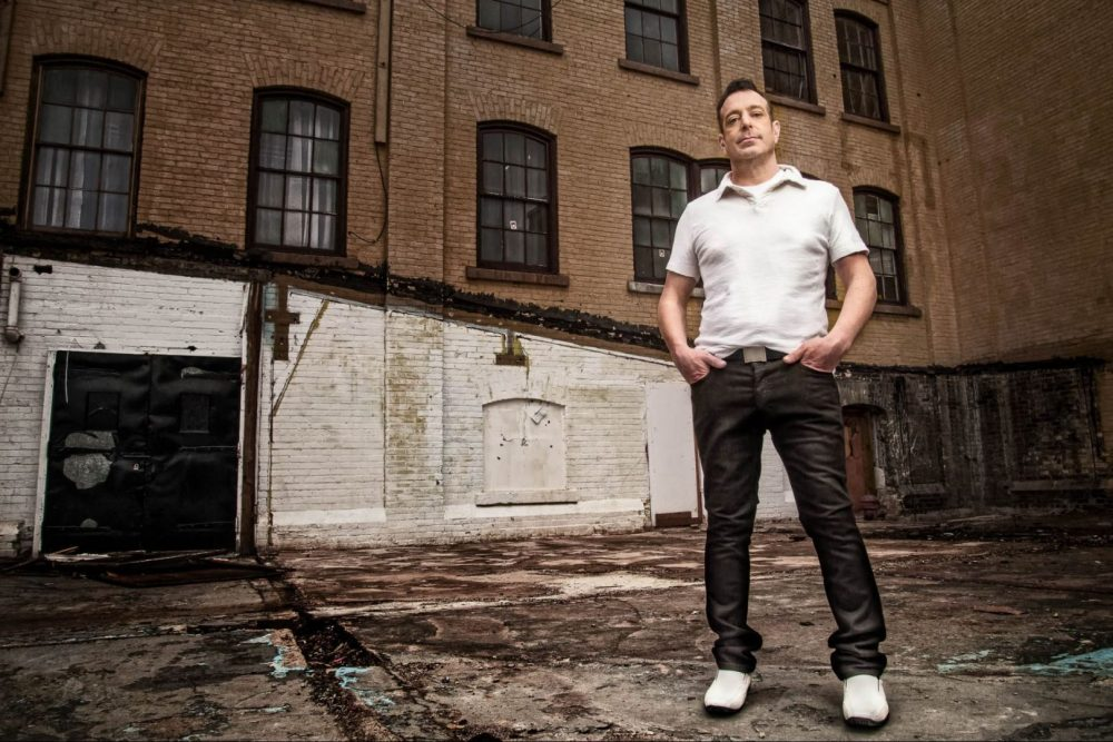 Environmental Portrait of DJ John Grenn in front of Grungy Building in Kitchener, Ontario photographed and edited by By Brandon Marsh Photography