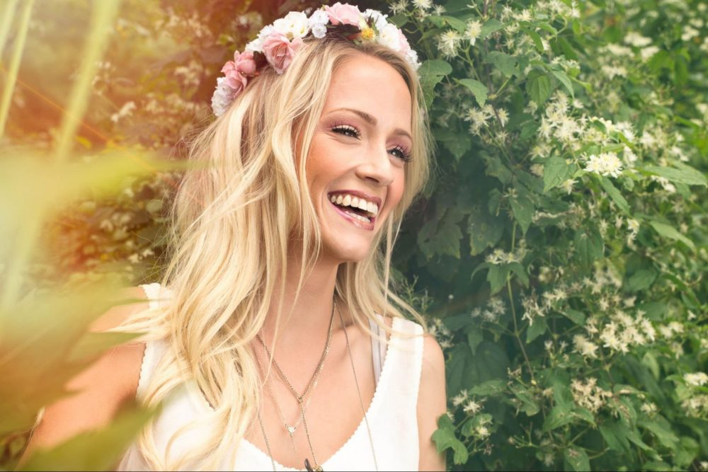 Bohemian Fashion Portrait of Model in Flower crown smiling in nature By Brandon Marsh Photography at University of Guelph Arboretum