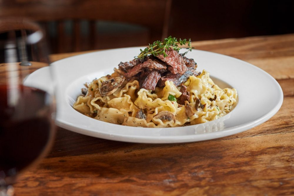 Food Photography of Bistecca Pasta dish at ennios pasta house in kitchener and waterloo ontario Photographed by Brandon Marsh Photography