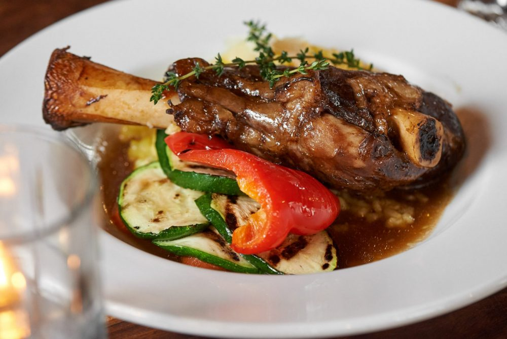Food photography of Lamb Shank dish at Ennios pasta house in Kitchener and Waterloo ontario Photographed by Brandon Marsh Photography