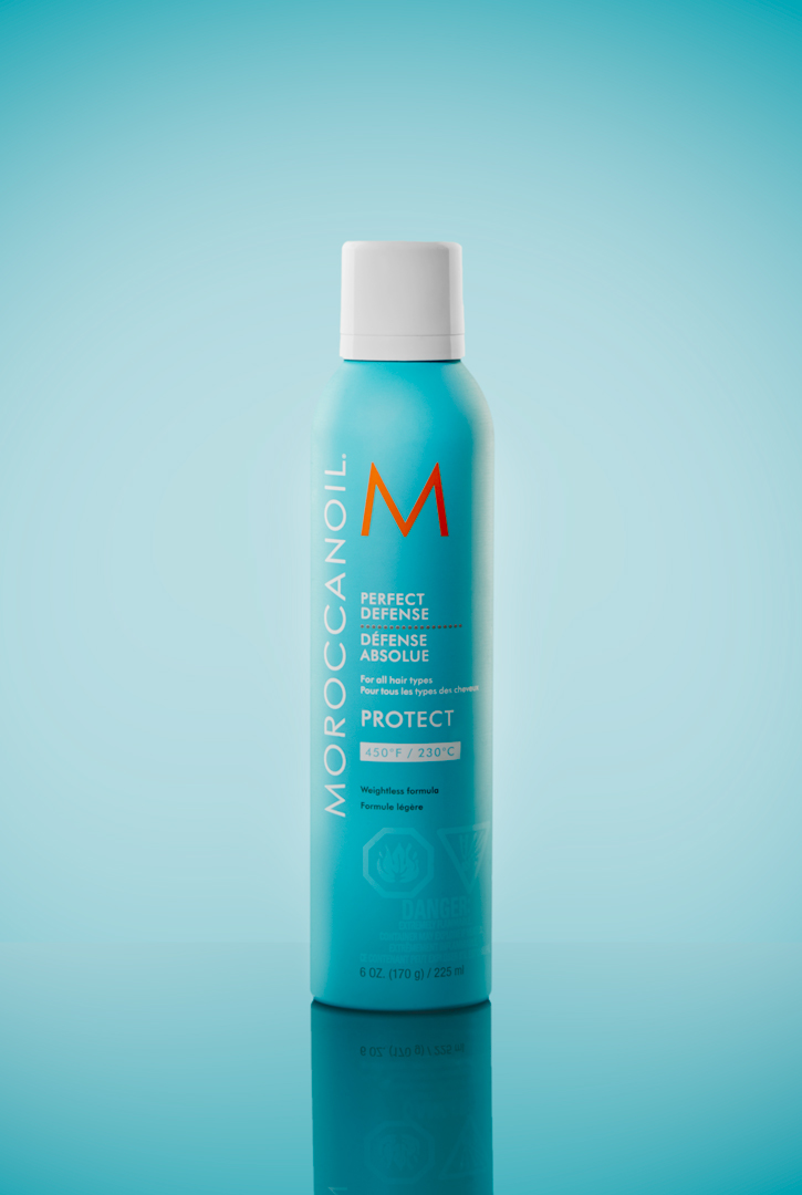 Product Photography of Moroccan Oil Perfect Defense product on Sky blue backdrop and reflective surface Photographed by Brandon Marsh Photography