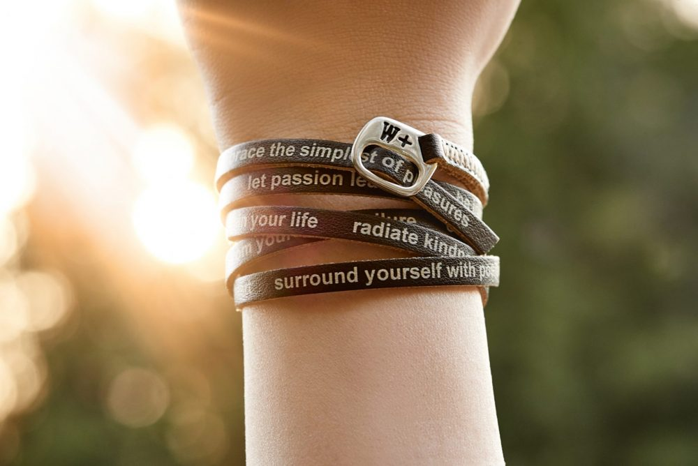 Lifestyle Product photo of model wearing WePositive bracelet from italy with sun flaring in the background Photographed by Brandon Marsh Photography