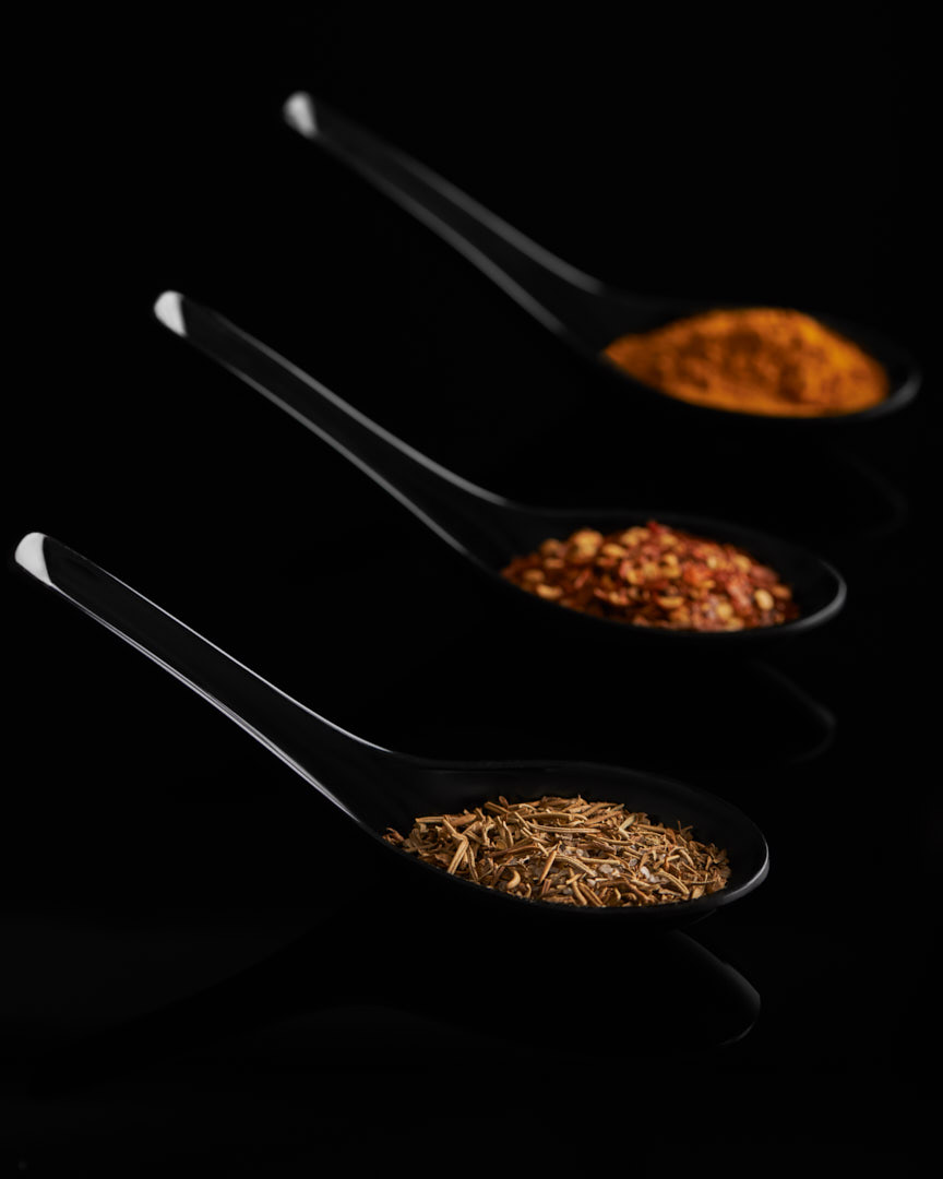 Moody food photography part 2 of various spices in black spoons Photographed by Brandon Marsh Photography