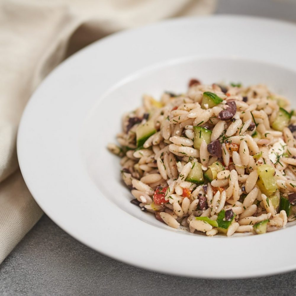Food Photography of a orzo pasta salad with olive, lemon, dill, cucumber and red peppers. Photographed by Brandon Marsh Photography