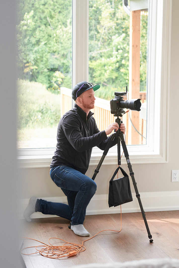 Behind the scenes photo of Brandon Marsh shooting interior images of a home in Southern Ontario by Assistant Laurie Cadman Creative