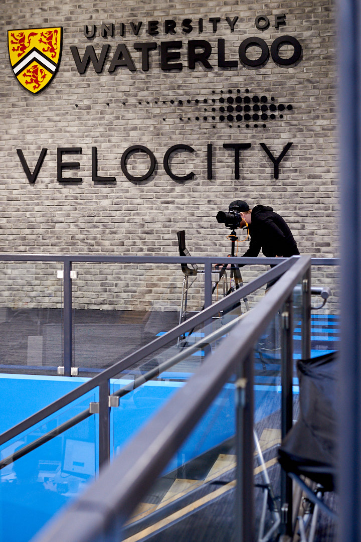 Behind the scenes photo of Brandon Marsh shooting architecture photography of University of Waterloo Velocity Garage in Kitchener-Waterloo Region's The Tannery Building by Assistant Laurie Cadman Creative
