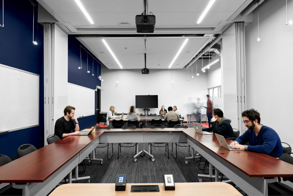 Architecture | Commercial interior photography of people hard at work in main conference room in University of Waterloo Velocity Garage in Kitchener-Waterloo Region's The Tannery Building by Brandon Marsh Photography
