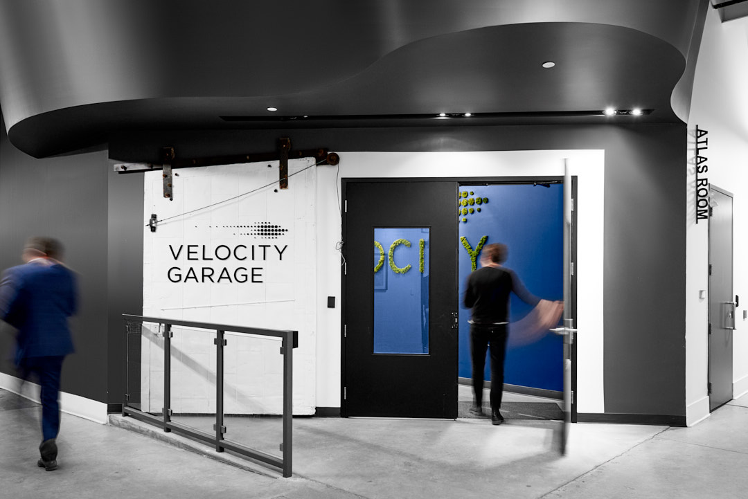 Architecture | Commercial interior photography of people entering University of Waterloo Velocity Garage in Kitchener-Waterloo Region's The Tannery Building by Brandon Marsh Photography