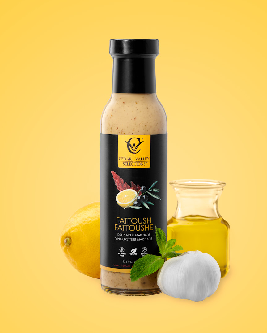 Product photography on yellow of Cedar Valley Selections Fattoush Salad Dressing and Marinade by Brandon Marsh Photography and Food Stylist Laurie Cadman Creative