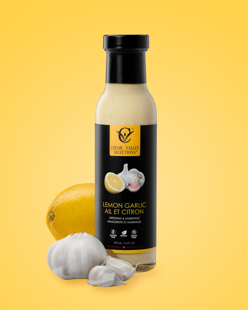 Product photography on yellow of Cedar Valley Selections Lemon Garlic Salad Dressing and Marinade by Brandon Marsh Photography and Food Stylist Laurie Cadman Creative