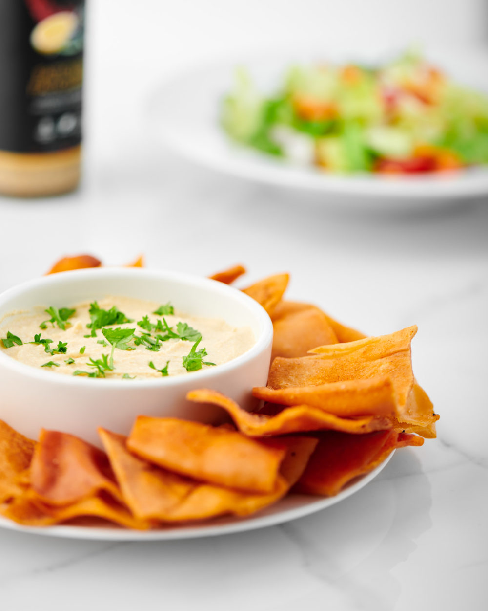 Food photography of Cedar Valley Selections pita chips with homemade hummus dip by Brandon Marsh Photography and Food Stylist Laurie Cadman Creative