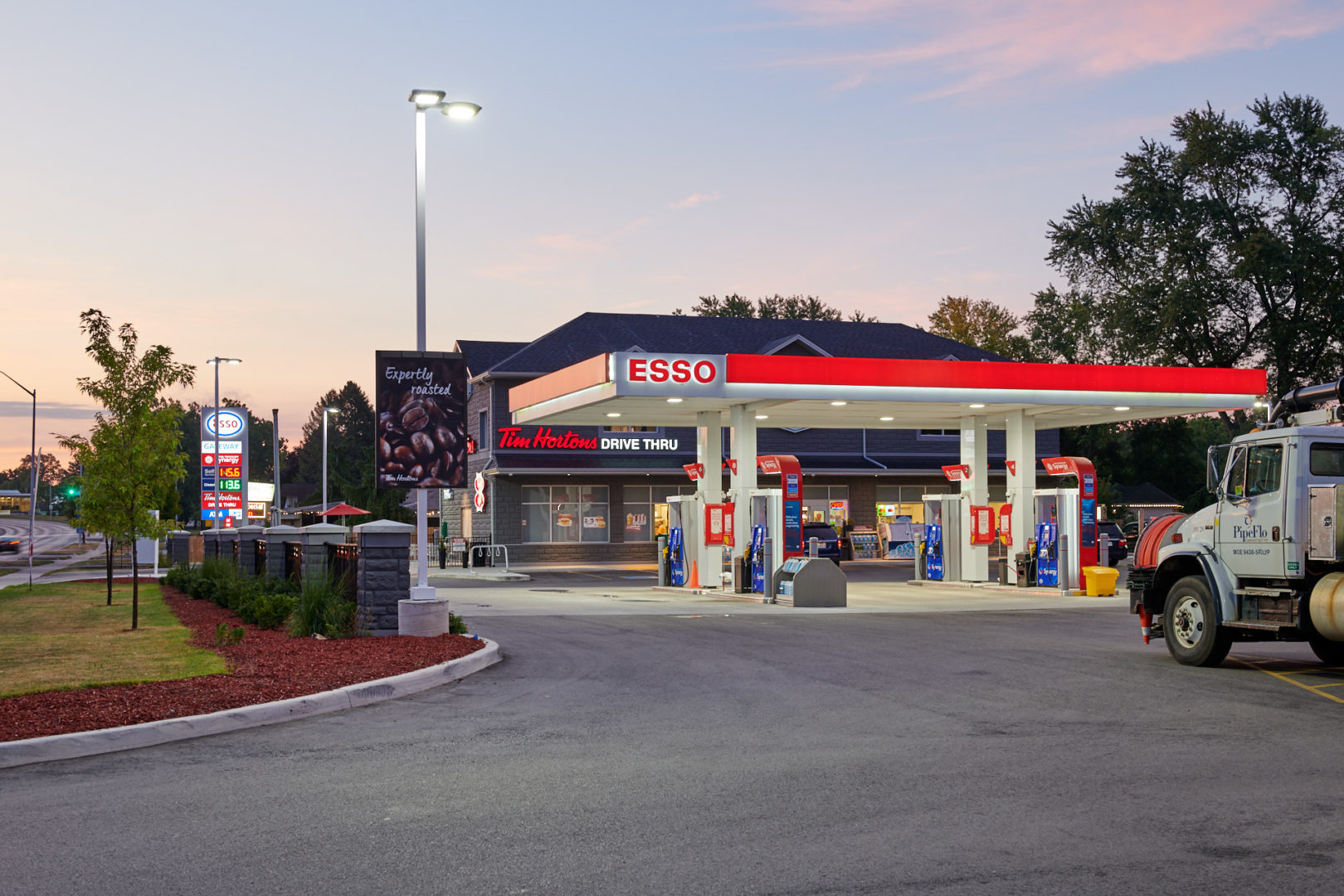 Before and After image of Global Fuels Esso Gas station in Burlington, Ontario photographed by architectural photographer Brandon Marsh Photography