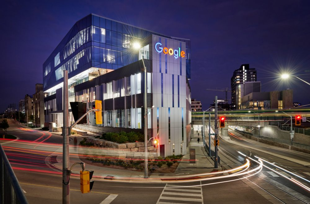 Twilight Architecture Photography of Google office with active city surrounding the buildingin Kitchener-Waterloo Region by Brandon Marsh Photography